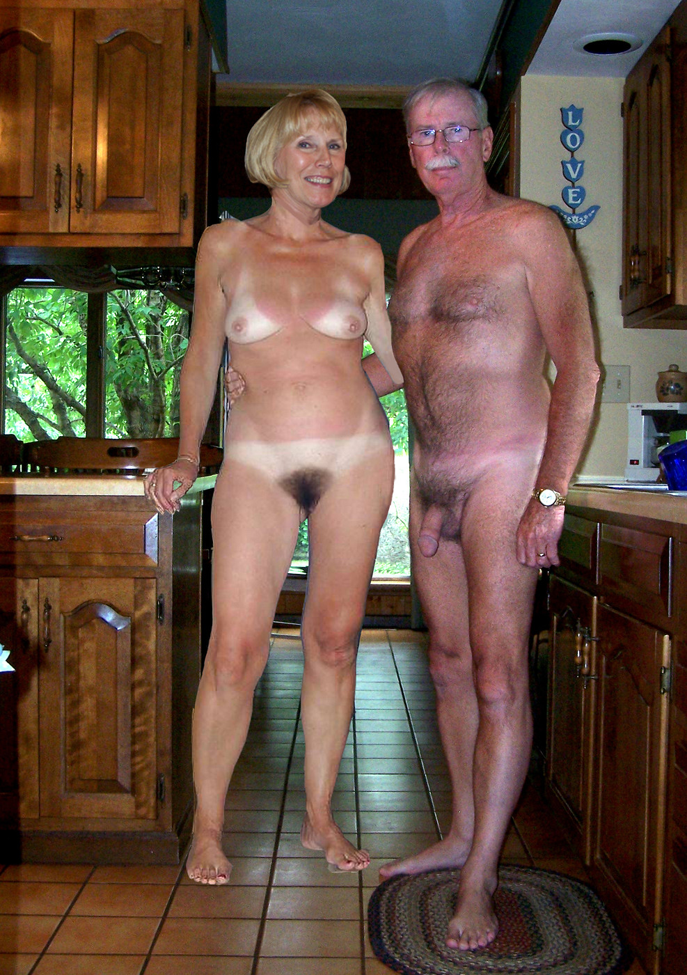 Shelley Brown and Paul Adams nude in the Adams' kitchen
